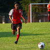 Logansport Berries midfielder Raul Rodriguez (21) chases down the ball during the season opener between the Logansport Berries and Frankfort Hotdogs at Logansport High School in Logansport on Tuesday, Aug. 17, 2021.