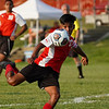 Logansport Berries midfielder Raul Rodriguez (21) goes to kick the ball during the season opener between the Logansport Berries and Frankfort Hotdogs at Logansport High School on Tuesday, Aug. 17, 2021.