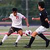 Logansport Berries midfielder Raul Rodriguez (21) handles the ball during the Logansport sectional at Logansport Memorial Hospital Stadium on Monday, Oct. 4, 2021.
