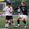 Logansport Berries forward Salvador Moreno-Gonzales (12) dribbles the ball during the Logansport sectional at Logansport Memorial Hospital Stadium on Monday, Oct. 4, 2021.