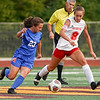 Kokomo Wildkats midfielder Emily Riggle (23) and Logansport Berries defender Arlene Frutos (8) battle for the ball during the first half of the Class 3A sectional semifinal at McCutcheon High School in Lafayette on Thursday, Oct. 7, 2021.
