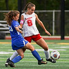 Logansport Berries defender Arlene Frutos (8) and Kokomo Wildkats midfielder Emily Riggle (23) fight for possession during the first half of the Class 3A sectional semifinal at McCutcheon High School in Lafayette on Thursday, Oct. 7, 2021.