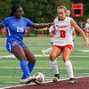 Kokomo Wildkats defender Darriuna Kirby (26) and defender Arlene Frutos (8) fight for possession during the first half of the Class 3A sectional semifinal at McCutcheon High School in Lafayette on Thursday, Oct. 7, 2021.