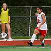 Logansport Berries midfielder Rossy Madrigal (12) kicks the ball during the first half of the Class 3A sectional semifinal at McCutcheon High School in Lafayette on Thursday, Oct. 7, 2021.