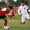 Logansport Berries forward Humberto Baez (7) tries to get the ball past Lafayette Jeff Bronchos defender Ruben Armenta (16) during a game between the Logansport Berries and Lafayette Jeff Bronchos at Logansport High School on Thursday, Sept. 2, 2021.