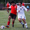 Logansport Berries forward Aldair Zarate (11) fight for possession during a game between the Logansport Berries and Lafayette Jeff Bronchos at Logansport High School on Thursday, Sept. 2, 2021.