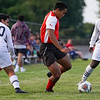 Logansport Berries defender Jesus Figueroa (16) handles the ball during a game between the Logansport Berries and Lafayette Jeff Bronchos at Logansport High School on Thursday, Sept. 2, 2021.