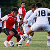 Logansport Berries forward Humberto Baez (7) tries to get the ball past Lafayette Jeff Bronchos defender Edwin Ruiz Cortez (18) during a game between the Logansport Berries and Lafayette Jeff Bronchos at Logansport High School on Thursday, Sept. 2, 2021.