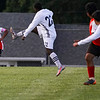 Logansport Berries midfielder Raul Rodriguez (21) kicks the ball during a game between the Logansport Berries and Lafayette Jeff Bronchos at Logansport High School on Thursday, Sept. 2, 2021.