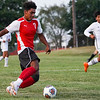 Logansport Berries forward Humberto Baez (7) goes to kick the ball during a game between the Logansport Berries and Lafayette Jeff Bronchos at Logansport High School on Thursday, Sept. 2, 2021.