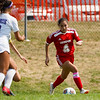 Logansport Berries defender Linney Fragoso (4) dribbles the ball during the first half of a game at Logansport High School on Saturday, Sept. 11, 2021.