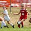 Logansport Berries midfielder Taylor Hamm (6) dribbles during the first half of a game at Logansport High School on Saturday, Sept. 11, 2021.