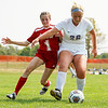 Logansport Berries forward Gracie Henderson (1) and Muncie Central Bearcats defender Sadie Hanna (26) fight for possession during the first half of a game at Logansport High School on Saturday, Sept. 11, 2021.