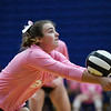 Caston Comets defensive specialist Kinzie Mollenkopf (24) digs the ball during a game at Caston High School in Fulton on Thursday, Sept. 16, 2021.