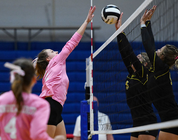 Caston Comets outside hitter Maddison Smith (5) has a tip blocked by Pioneer Panthers players during a game at Caston High School in Fulton on Thursday, Sept. 16, 2021.