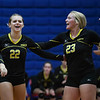 Pioneer Panthers setter Keirsten Nies (22) and Hailey Cripe (23) celebrate a point during a game at Caston High School in Fulton on Thursday, Sept. 16, 2021.