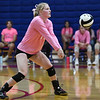 Caston Comets outside hitter Bailey Harness (17) digs the ball during a game at Caston High School in Fulton on Thursday, Sept. 16, 2021.