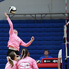 Caston Comets outside hitter Bailey Harness (17) hits the ball during a game at Caston High School in Fulton on Thursday, Sept. 16, 2021.