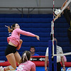 Caston Comets middle blocker Abby Williamson (6) goes for a kill during a game against the Pioneer Panthers at Caston High School in Fulton on Thursday, Sept. 16, 2021.