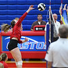 Caston Comets outside hitter Maddison Smith (5) goes for a kill during an HNAC game at Caston High School on Tuesday, Oct. 5, 2021.
