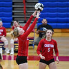 Caston Comets outside hitter Bailey Harness (1) sets during an HNAC game at Caston High School on Tuesday, Oct. 5, 2021.
