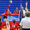 Caston Comets defensive specialist Macee Hinderlider (3) goes for a kill during an HNAC game at Caston High School on Tuesday, Oct. 5, 2021.
