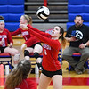 Caston Comets middle blocker Abby Williamson (6) hits the ball during an HNAC game at Caston High School on Tuesday, Oct. 5, 2021.