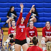 Caston Comets outside hitter Maddison Smith (5) sets during an HNAC game at Caston High School on Tuesday, Oct. 5, 2021.