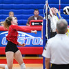Caston Comets outside hitter Maddison Smith (5) goes for a kill during an HNAC game against the Triton Trojans at Caston High School on Tuesday, Oct. 5, 2021.