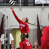 Caston Comets middle blocker Alexa Finke (4) hits the ball over the net during a game against the Winamac Warriors at Winamac Community High School on Thursday, Sept. 9, 2021.