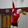 Caston Comets outside hitter Bailey Harness (1) serves during a game at Winamac Community High School on Thursday, Sept. 9, 2021.