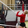 Caston Comets outside hitter Bailey Harness (1) goes for a kill during a game at Winamac Community High School on Thursday, Sept. 9, 2021.