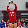 Caston Comets setter Delaney Lowry (24) sets during a game at Winamac Community High School on Thursday, Sept. 9, 2021.
