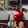 Caston Comets outside hitter Maddison Smith (5) goes for a kill during a game against the Winamac Warriors at Winamac Community High School on Thursday, Sept. 9, 2021.
