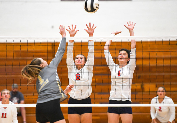 Lewis Cass Kings outside hitter Cana Jones (6) and middle hitter Abbey Hileman (1) go to block a kill during a game against the Rochester Zebras at Lewis Cass Jr./Sr. High School in Walton on Monday, Sept. 27, 2021.