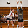 Lewis Cass Kings middle hitter Kendal Johnson (12) goes for a kill during a game at Lewis Cass Jr./Sr. High School in Walton on Monday, Sept. 27, 2021.