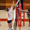 Lewis Cass Kings middle hitter Kendal Johnson (12) blocks a kill during a game at Lewis Cass Jr./Sr. High School in Walton on Monday, Sept. 27, 2021.