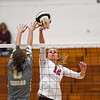 Lewis Cass Kings middle hitter Kendal Johnson (12) tips the ball during a game at Lewis Cass Jr./Sr. High School in Walton on Monday, Sept. 27, 2021.