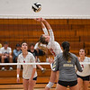 Lewis Cass Kings middle hitter Kendal Johnson (12) sets during a game at Lewis Cass Jr./Sr. High School in Walton on Monday, Sept. 27, 2021.