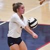 A Lewis Cass Kings player digs the ball during a game at Lewis Cass Jr./Sr. High School in Walton on Monday, Sept. 27, 2021.