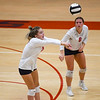 Lewis Cass Kings defensive specialist Ashlee Lindley (21) digs the ball during a game at Lewis Cass Jr./Sr. High School in Walton on Monday, Sept. 27, 2021.