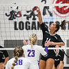 Logansport Berries' Laine McLochlin (11) hits the ball during a game between the Logansport Berries and Northwestern Tigers at the Berry Bowl in Logansport on Thursday, Aug. 19, 2021.