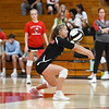 Logansport Berries' Justice Rohrabaugh (3) digs the ball during a game between the Logansport Berries and Northwestern Tigers at the Berry Bowl in Logansport on Thursday, Aug. 19, 2021.
