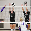 Logansport Berries' Finley Hettinger (6) and Alicia Sutton (19) try to block a kill attempt from Northwestern Tigers' Emily Goltz (21) during a game between the Logansport Berries and Northwestern Tigers at the Berry Bowl in Logansport on Thursday, Aug. 19, 2021.