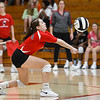 Logansport Berries' Halle Rennewanz (4) digs the ball during a game between the Logansport Berries and Northwestern Tigers at the Berry Bowl in Logansport on Thursday, Aug. 19, 2021.