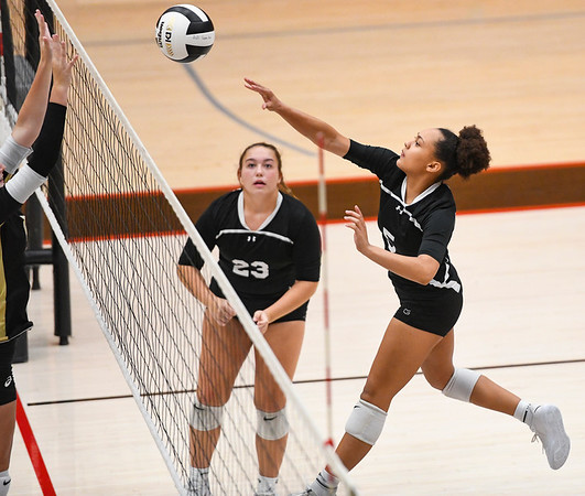 Logansport Berries' Ambria Gittings (5) hits the ball over the net during a game against the Peru Tigers at the Berry Bowl in Logansport on Tuesday, Sept. 28, 2021.