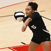 Logansport Berries' Ambria Gittings (5) digs the ball during a game at the Berry Bowl in Logansport on Tuesday, Sept. 28, 2021.
