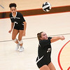 Logansport Berries' Katey Hall (23) digs the ball during a game at the Berry Bowl in Logansport on Tuesday, Sept. 28, 2021.