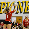 Logansport Berries' Finley Hettinger (6) sets over the net during a game between the Pioneer Panthers and Logansport Berries at Pioneer Jr./Sr. High School in Royal Center on Tuesday, Aug. 31, 2021.