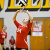 Logansport Berries' Chloe Kelly (34) sets the ball during a game between the Pioneer Panthers and Logansport Berries at Pioneer Jr./Sr. High School in Royal Center on Tuesday, Aug. 31, 2021.